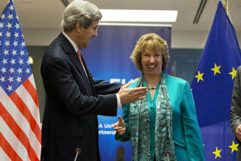 European Union High Representative Catherine Ashton, right, laughs as U.S. Secretary of State John Kerry, turns to give her a hug at the start of a US-EU Energy Dialogue meeting at the headquarters of the European Union in Brussels Wednesday April 2, 2014. (AP Photo/Jacquelyn Martin, Pool)