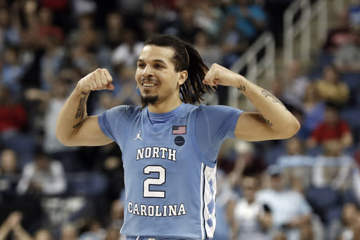 FILE - In this March 10, 2020, file photo, North Carolina guard Cole Anthony reacts during the second half of an NCAA college basketball game against Virginia Tech at the Atlantic Coast Conference tournament in Greensboro, N.C. Anthony was selected by the Orlando Magic in the NBA draft Wednesday, Nov. 18, 2020. (AP Photo/Gerry Broome, File)