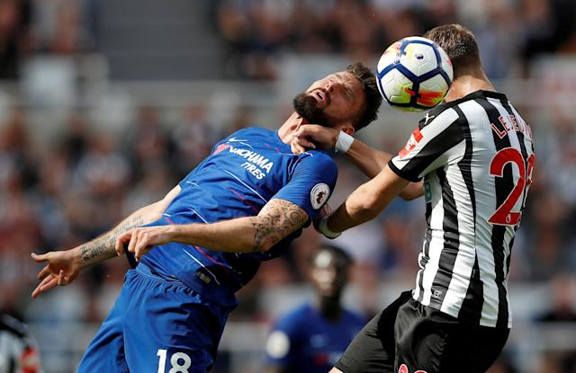 "Soccer Football - Premier League - Newcastle United vs Chelsea - St James' Park, Newcastle, Britain - May 13, 2018 Chelsea's Olivier Giroud in action with Newcastle United's Florian Lejeune Action Images via Reuters/Lee Smith EDITORIAL USE ONLY. No use with unauthorized audio, video, data, fixture lists, club/league logos or ""live"" services. Online in-match use limited to 75 images, no video emulation. No use in betting, games or single club/league/player publications. Please contact your account representative for further details. TPX IMAGES OF THE DAY"