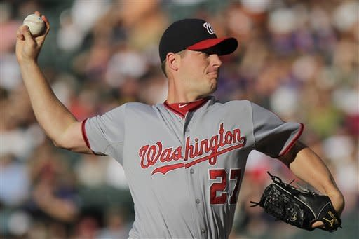 Washington Nationals starting pitcher Jordan Zimmermann (27) pitches to Colorado Rockies' Dexter Fowler during the first inning of a baseball game on Wednesday, June 27, 2012, in Denver, Colo. (AP Photo/Barry Gutierrez)