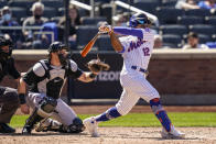 New York Mets' Francisco Lindor hits a single off Miami Marlins starting pitcher Nick Neidert during the fifth inning of a baseball game, Thursday, April 8, 2021, in New York. (AP Photo/John Minchillo)