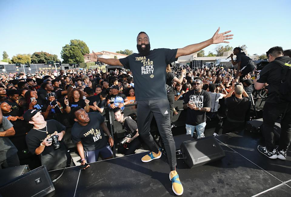 "James Harden stands onstage at ""Imma Be a Star"" Block Party at Audubon Middle School. (Getty Images for Adidas)"