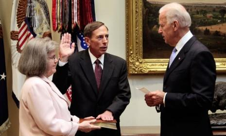 David Petraeus is sworn in as CIA Director while his wife, Holly Knowlton Petraeus holds the family bible on Sept. 6, 2011.