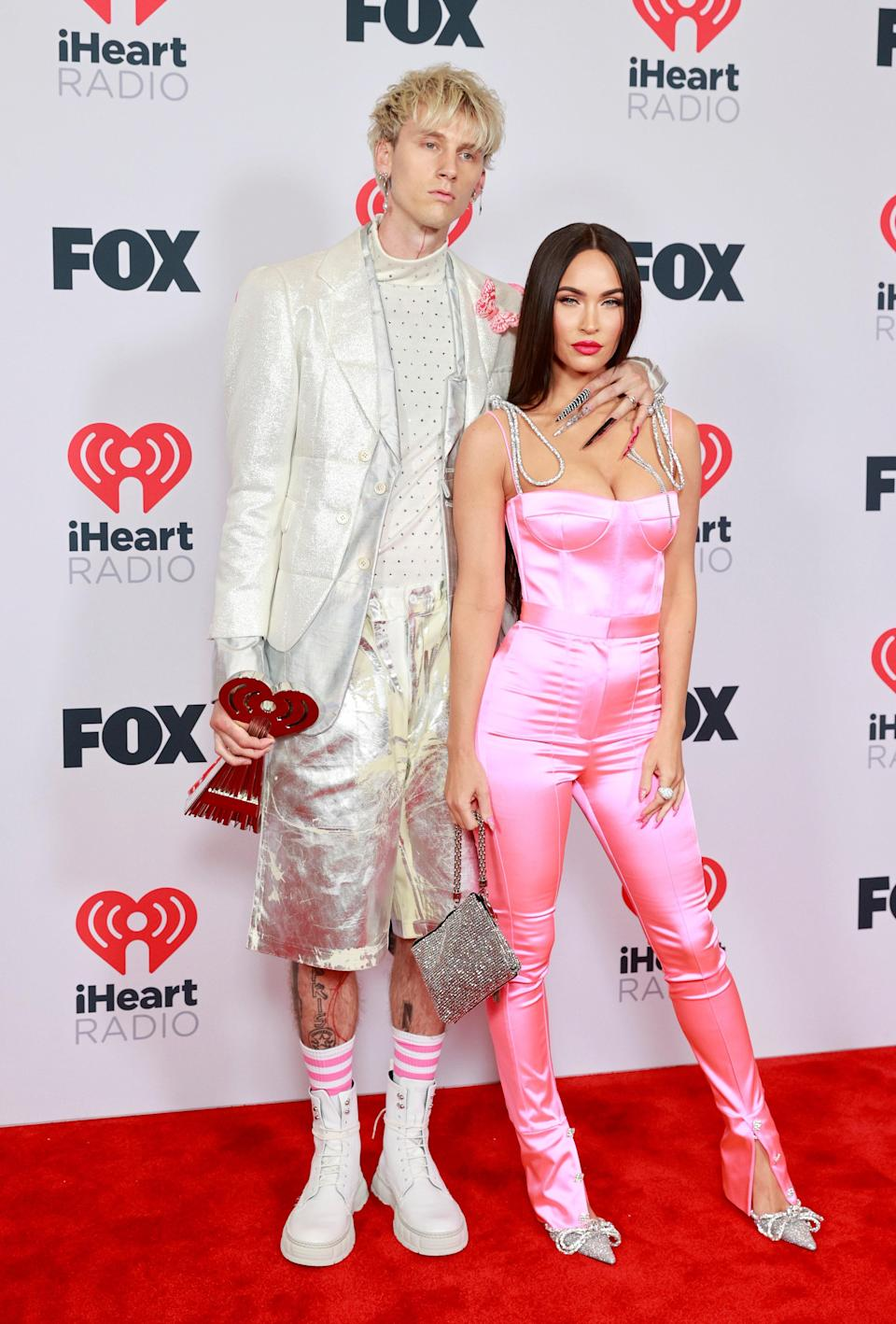 Couple of the moment Megan Fox and Machine Gun Kelly know how to serve an iconic photo moment and this was no exception. Styled by Maeve Reilly, Megan arrived in a barbie pink MACH & MACH jumpsuit. She looked breathtaking in a fitted silky ensemble that matched MGK's pink and white tube socks. He was styled by Adam Ballheim and wore an icy Comme des Garçons look – complete with an extra-long manicure.