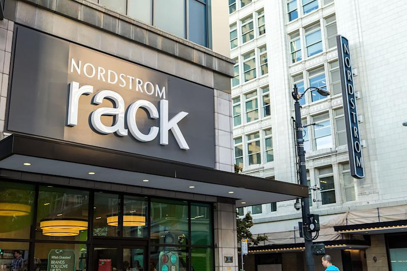 The entrance to a Nordstrom Rack store, with a Nordstrom full-line store in the background.