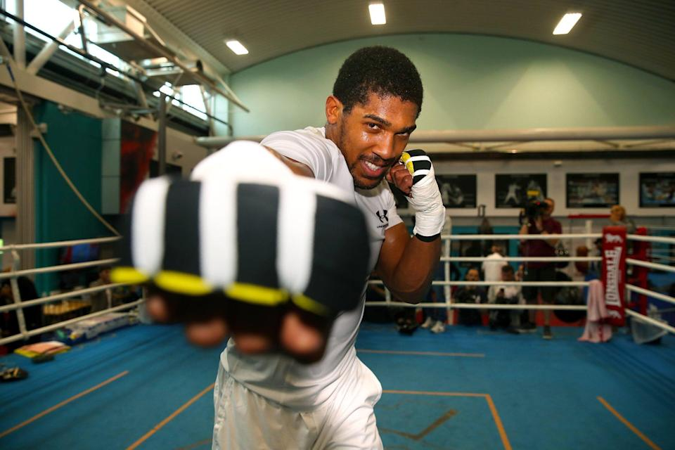 Hitting out: Anthony Joshua pushes himself hard in training as he prepares for Alexander Povetkin, one of the toughest opponents of his career: PA
