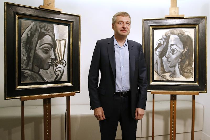 The president of football club AS Monaco, Dmitry Rybolovlev, poses in Paris on September 24, 2015 in front of two allegedly stolen paintings by Pablo Picasso which he purchased from a Swiss art dealer