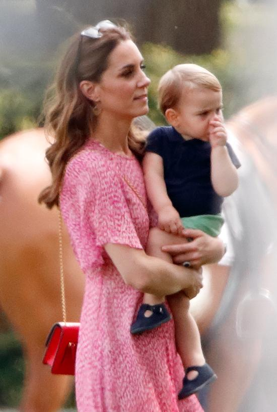 Duchess Kate pictured with Prince Louis in July 2019 at the King Power Royal Charity Polo Match. [Photo: Getty]