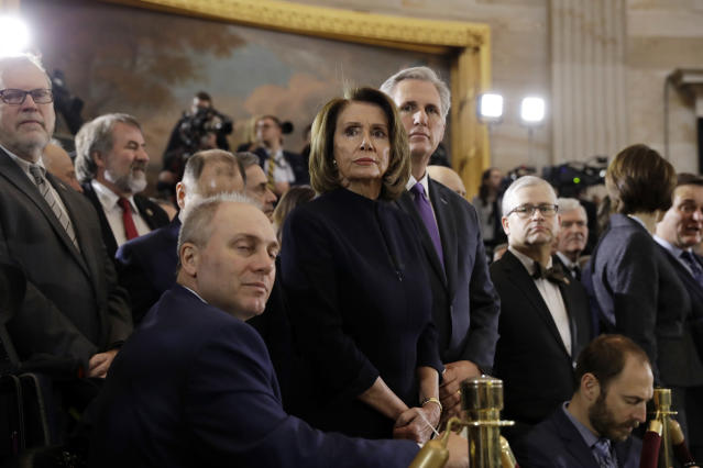 <p>House Majority Whip Steve Scalise, R-La., foreground, House Minority Leader Nancy Pelosi, D-Calif., center and House Majority Leader Kevin McCarthy, R-Calif., right and waits for the ceremony to begin honoring Reverend Billy Graham in the Rotunda of the U.S. Capitol building, Wednesday, Feb. 28, in Washington. (Photo: Evan Vucci/AP) </p>