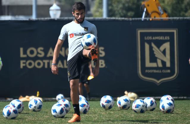"Starting next week, MLS players like LAFC's <a class=""link rapid-noclick-resp"" href=""/soccer/players/732622/"" data-ylk=""slk:Diego Rossi"">Diego Rossi</a> will be allowed to return to team facilities for individual workouts. (Frederic Brown/Getty)"