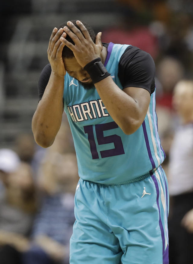Charlotte Hornets' Kemba Walker (15) reacts to being called for a foul against the Miami Heat during the second half of an NBA basketball game in Charlotte, N.C., Saturday, Jan. 20, 2018. (AP Photo/Chuck Burton)