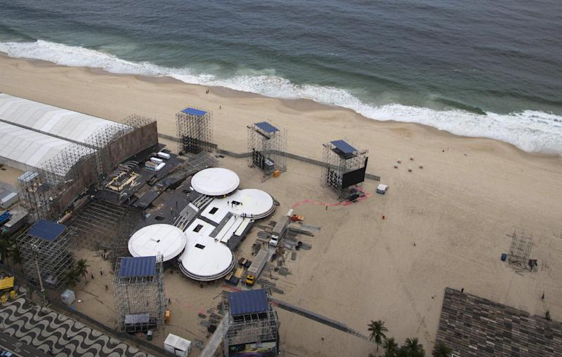 Workers build a stage on Copacabana beach in preparation for the upcoming visit by Pope Francis in Rio de Janeiro, Brazil, Tuesday, July 16, 2013. Pope Francis will travel to Brazil and participate in World Youth Day events from July 22-28. (AP Photo/Felipe Dana)