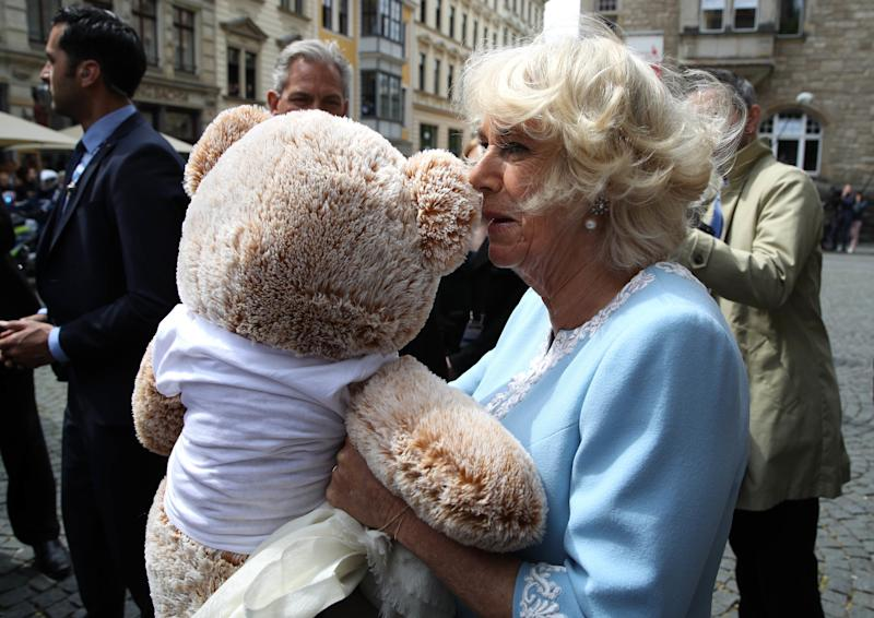 Camilla Parker Bowles toting a giant teddy bear that an admirer gave her during an official visit to Leipzig, Germany, May 2019.