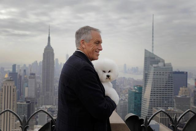 Flynn, a bichon frise and winner of Best In Show at the 142nd Westminster Kennel Club Dog Show, is held by handler Bill McFadden at the Top of the Rock in New York, U.S., February 14, 2018. REUTERS/Lucas Jackson