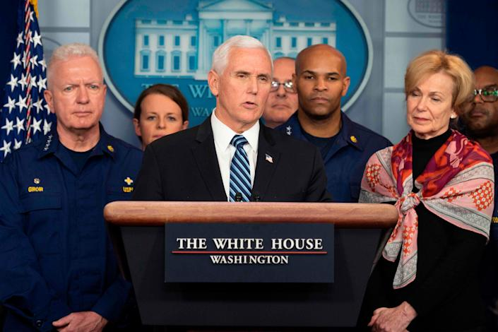 US Vice President Mike Pence, standing with members of the White House Coronavirus Task Force team, speaks during a press briefing in the press briefing room of the White House in Washington, DC on March 20, 2020.
