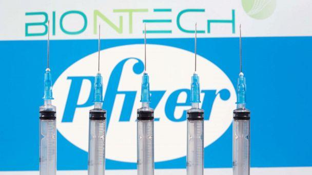 PHOTO: Syringes are seen in front of the displayed logos of BioNTech and Pfizer in this illustration taken on Nov. 10, 2020. (Dado Ruvic/Reuters)