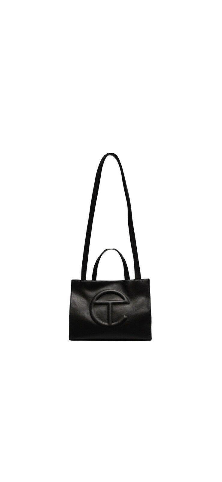 """<p><strong>Telfar</strong></p><p>ebay.com</p><p><strong>$385.00</strong></p><p><a href=""""https://go.redirectingat.com?id=74968X1596630&url=https%3A%2F%2Fwww.ebay.com%2Fitm%2F274433484383&sref=https%3A%2F%2Fwww.harpersbazaar.com%2Ffashion%2Ffashion-week%2Fg30766342%2Ffall-2020-bag-trends%2F"""" rel=""""nofollow noopener"""" target=""""_blank"""" data-ylk=""""slk:Shop Now"""" class=""""link rapid-noclick-resp"""">Shop Now</a></p><p>While you're waiting on a restock, you can try your hand at the resale market. </p>"""