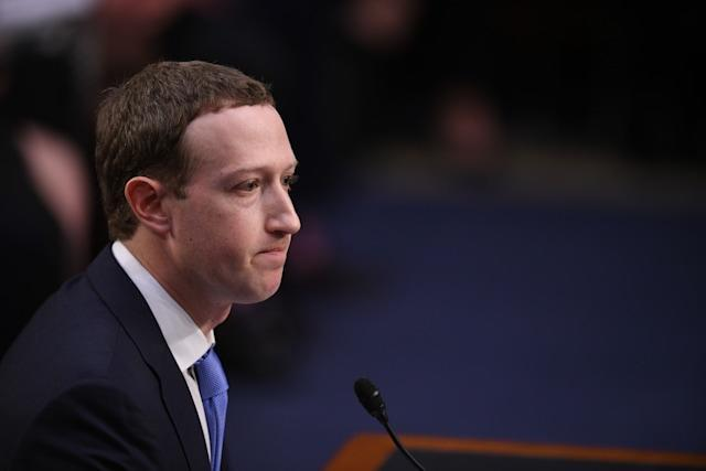 Facebook CEO Mark Zuckerberg testifies before a joint hearing of the US Senate Commerce, Science and Transportation Committee and Senate Judiciary Committee on Capitol Hill, April 10, 2018 in Washington, DC. Zuckerberg, making his first formal appearance at a Congressional hearing, seeks to allay widespread fears ignited by the leaking of private data on tens of millions of users to British firm Cambridge Analytica working on Donald Trump's 2016 presidential campaign. / AFP PHOTO / JIM WATSON (Photo credit should read JIM WATSON/AFP via Getty Images)