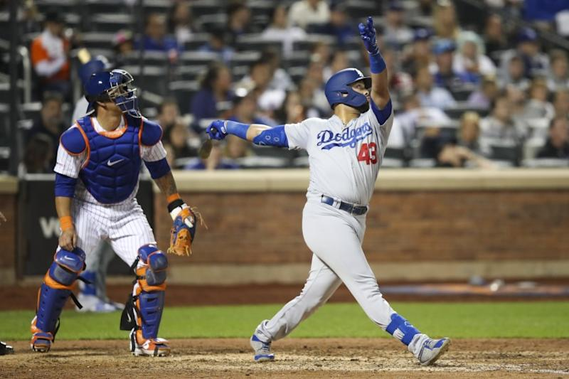 Los Angeles Dodgers' Edwin Rios watches his two-run home run during the eighth inning of the team's baseball game against the New York Mets, Friday, Sept. 13, 2019, in New York. (AP Photo/Mary Altaffer)
