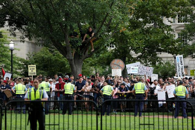 "<p>Counter-protesters are watched by police near a white nationalist-led rally marking the one year anniversary of the 2017 Charlottesville ""Unite the Right"" protests, in Washington, D.C. August 12, 2018. (Photo: Jim Urquhart/Reuters) </p>"