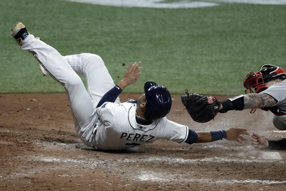 Tampa Bay Rays' Michael Perez, left, scores ahead of the tag by Boston Red Sox catcher Christian Vazquez on an RBI triple by Austin Meadows during the fifth inning of a baseball game Tuesday, Aug. 4, 2020, in St. Petersburg, Fla. (AP Photo/Chris O'Meara)