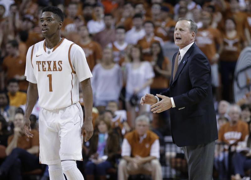 Texas coach Rick Barnes, right, talks with Isaiah Taylor during the first half of an NCAA college basketball game against Kansas, Saturday, Feb. 1, 2014, in Austin, Texas. (AP Photo/Eric Gay)