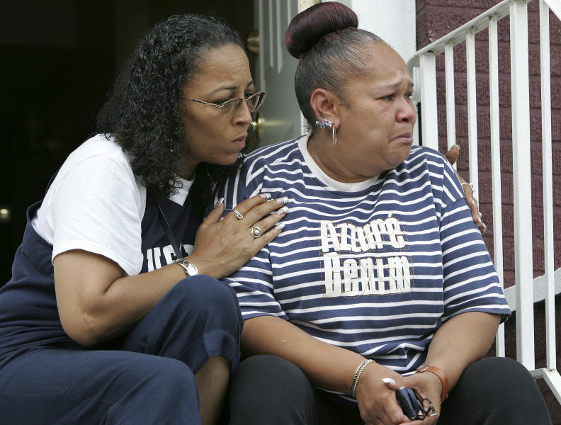 FILE - In this Monday Aug. 6, 2007 file photograph, Shalga Hightower, right, is consoled by family friend Cathy Rainey, at Hightower's Newark, N.J. home, as she talks about her daughter, Iofemi Hightower, 20, who was killed in an execution-style shooting of four young friends in a schoolyard late Saturday night, Aug. 4, 2007. Iofemi Hightower, Terrance Aeriel, 18, and Dashon Harvey, 20 were killed. Aeriel's 19-year-old sister, Natasha, was wounded. The trial of Gerardo Gomez,the last of six defendants in the triple murder case, is scheduled to begin Thursday, Oct. 4, 2012. (AP Photo/Mel Evans, File)
