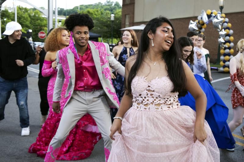 FILE - In this June 23, 2020, file photo, Steel Valley High School students dance at their prom at the Waterfront Shopping Center in Homestead, Pa., organized by one of the student's father after the school's prom was canceled amid the coronavirus pandemic. Amid the debate over how to reopen schools safely, some teens and parents are organizing private proms to replace events canceled because of the coronavirus. (Lily LaRegina/Pittsburgh Post-Gazette via AP, File)