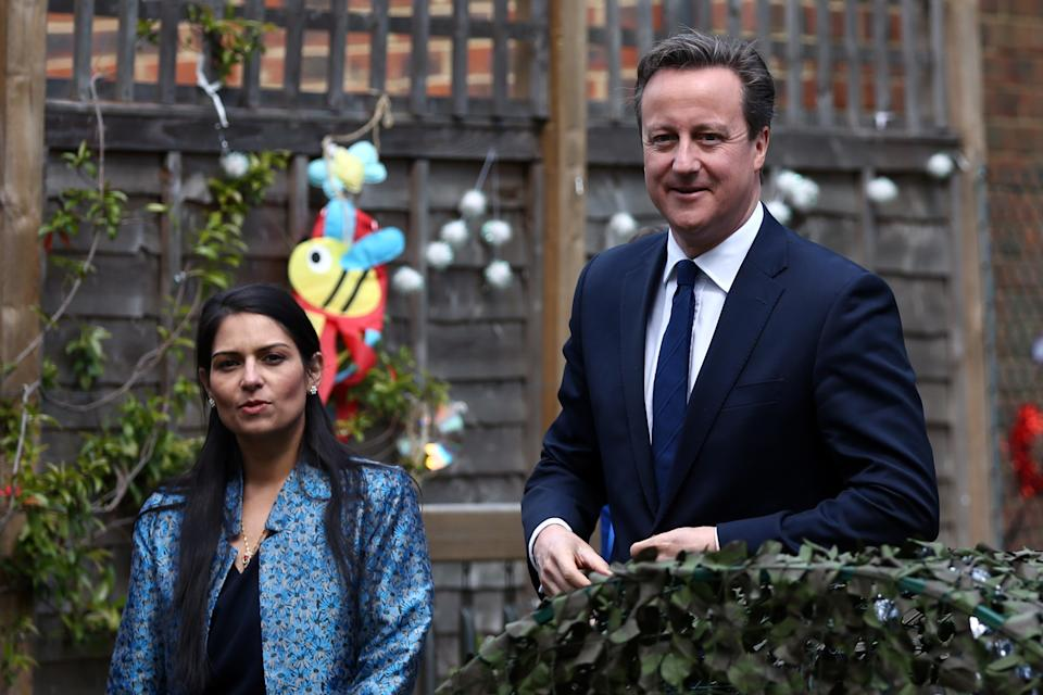 LONDON, ENGLAND - JUNE 01: Prime Minister David Cameron (R) walks with Employment Minister Priti Patel during a visit to a children's nursery on June 1, 2015 in London, England. The new Childcare Bill will see free early education or childcare allowances double for working parents with a household income of less than £150,000 - although it is not currently clear how many hours they will have to work in order to qualify. (Photo by Carl Court - WPA Pool / Getty Images)