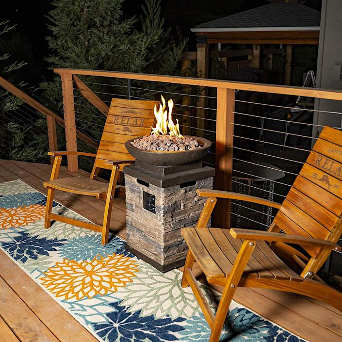"""Last but not least on our list of outdoor fire pit ideas is this stunner. How grand is this propane-powered fire bowl that sits atop a stone pillar? $399, Amazon. <a href=""""https://www.amazon.com/Bond-63172-Newcastle-Propane-Firebowl/dp/B001H1HL76/ref=sr_1_24"""" rel=""""nofollow noopener"""" target=""""_blank"""" data-ylk=""""slk:Get it now!"""" class=""""link rapid-noclick-resp"""">Get it now!</a>"""