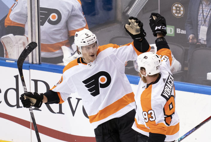 Philadelphia Flyers defenseman Philippe Myers (5) celebrates his goal with right wing Jakub Voracek (93) against the Boston Bruins during second-period NHL hockey playoff action in Toronto, Sunday, Aug. 2, 2020. (Frank Gunn/The Canadian Press via AP)