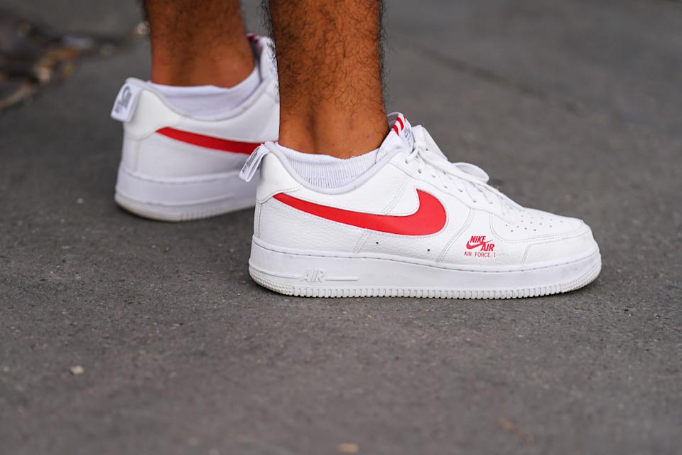 PARIS, FRANCE - JULY 25: A passerby wears white and red Nike Air Force 1 sneakers shoes, on July 25, 2020 in Paris, France. (Photo by Edward Berthelot/Getty Images)
