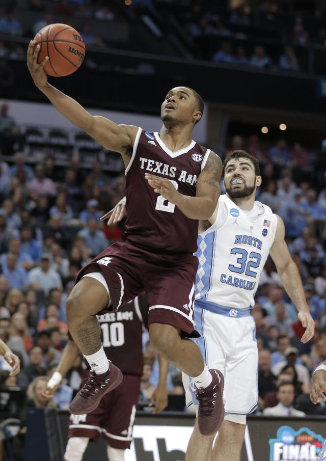 Texas A&M's TJ Starks (2) drives past North Carolina's Luke Maye (32) during the second half of a second-round game in the NCAA men's college basketball tournament in Charlotte, N.C., Sunday, March 18, 2018. (AP Photo/Bob Leverone)