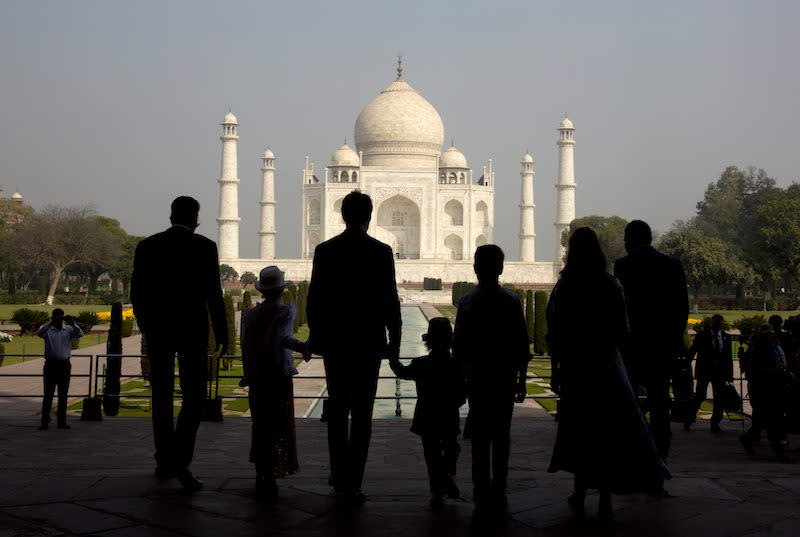 <p>Prime Minister Justin Trudeau walks with his family up to the Taj Mahal. He was expected to focus on civil nuclear co-operation, space, defence, energy and education during his visit to India. Photo from The Associated Press via The Canadian Press. </p>
