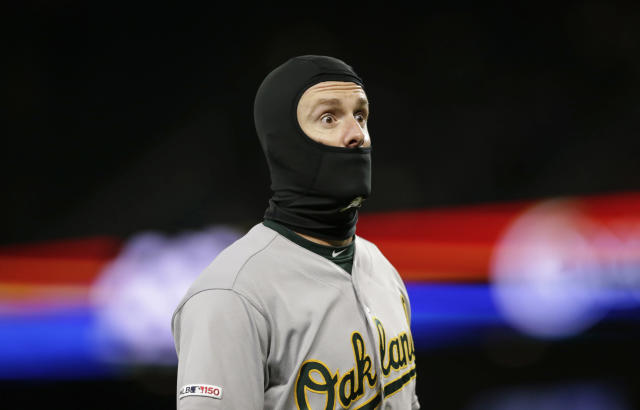 Oakland Athletics' Mark Canha reacts while walking to the dugout after the final out of the middle of the sixth inning against the Seattle Mariners during a baseball game, Saturday, Sept. 28, 2019, in Seattle. (AP Photo/John Froschauer)
