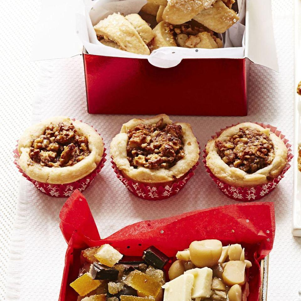 """<p>These easier-than-apple-pie tartlets are a fun (and portable!) way to enjoy an all-American treat.</p><p><em><a href=""""https://www.goodhousekeeping.com/food-recipes/a15284/apple-walnut-tartlets-recipe-ghk1213/"""" rel=""""nofollow noopener"""" target=""""_blank"""" data-ylk=""""slk:Get the recipe for Apple-Walnut Tartlets »"""" class=""""link rapid-noclick-resp"""">Get the recipe for Apple-Walnut Tartlets »</a></em></p>"""