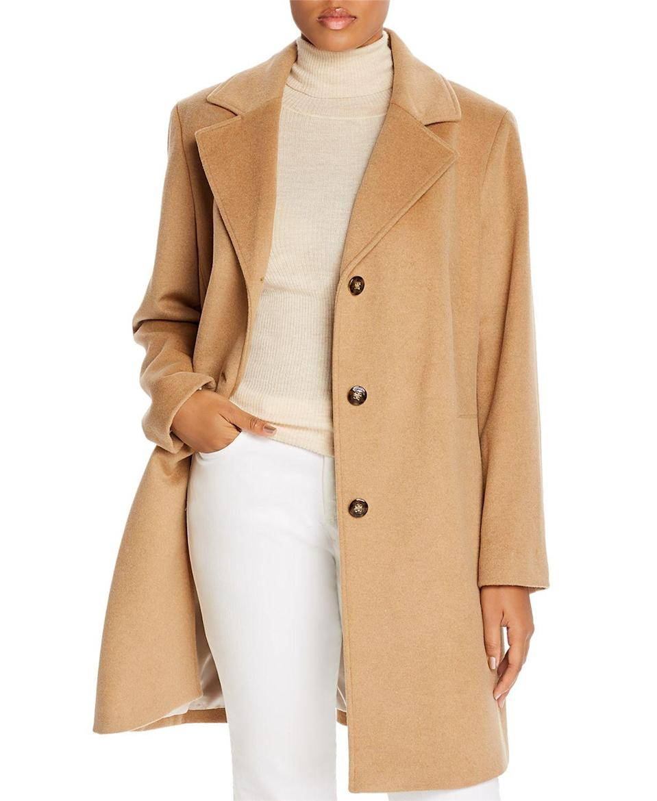"""<p><strong>Calvin Klein Plus</strong></p><p>bloomingdales.com</p><p><strong>$194.60</strong></p><p><a href=""""https://go.redirectingat.com?id=74968X1596630&url=https%3A%2F%2Fwww.bloomingdales.com%2Fshop%2Fproduct%2Fcalvin-klein-plus-long-wool-blend-coat%3FID%3D3519060&sref=https%3A%2F%2Fwww.oprahmag.com%2Fstyle%2Fg33266496%2Fplus-size-coats%2F"""" rel=""""nofollow noopener"""" target=""""_blank"""" data-ylk=""""slk:SHOP NOW"""" class=""""link rapid-noclick-resp"""">SHOP NOW</a></p><p>We can't say it enough: A camel coat is a wardrobe essential for every woman. It elevates anything (trust us, even loungewear) and goes with anything. </p>"""