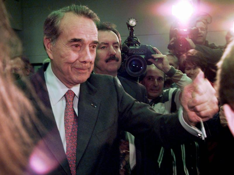 Kansas Senator Bob Dole gives a happy thumbs-up to supporters at a caucus event in Clive, Iowa, Monday, Feb. 12, 1996.