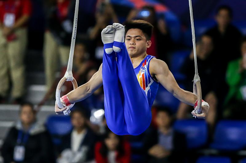 MANILA, Dec. 3, 2019 -- Carlos Edriel Yulo of the Philippines competes during the final match of the men's gymnastic artistic still rings at the Southeast Asian Games 2019 in Manila, the Philippines, Dec. 3, 2019. (Photo by Rouelle Umali/Xinhua via Getty Images)