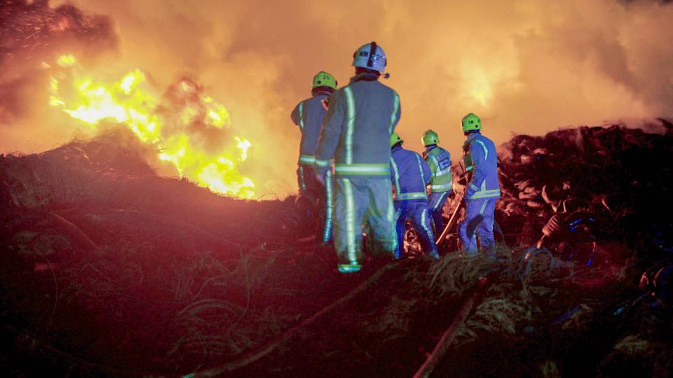 Firefighters from various stations tackle a huge blaze at a tyre storage facility in central Bradford. (BBC/Wise Owl Films)