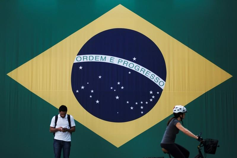 Brazil rates to hit record low 5.00%, seen falling further: Reuters poll