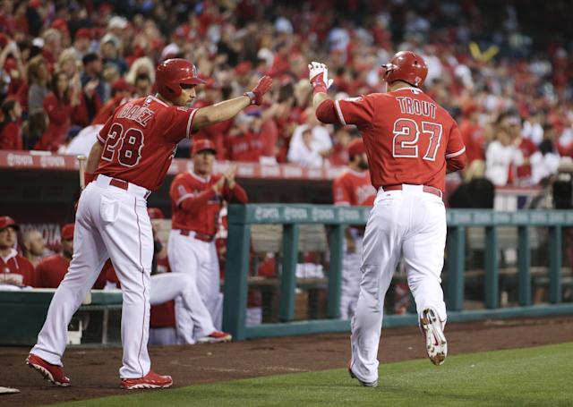 Los Angeles Angels' Mike Trout, right, celebrates his home run with teammate Raul Ibanez during the first inning of a baseball game against the New York Mets, Friday, April 11, 2014, in Anaheim, Calif. (AP Photo/Jae C. Hong)