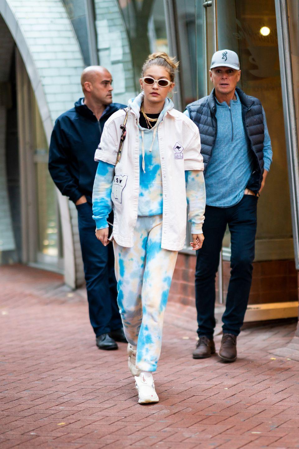 """<p>As further proof that there's nothing she can't pull off, Gigi just stepped out in a full, head-to-toe tie dye outfit. She wore a <a href=""""https://go.redirectingat.com?id=74968X1596630&url=https%3A%2F%2Fwww.bandier.com%2Fraglan-hoodie-3&sref=https%3A%2F%2Fwww.seventeen.com%2Ffashion%2Fceleb-fashion%2Fg3011%2Fgigi-hadid-street-style%2F"""" rel=""""nofollow noopener"""" target=""""_blank"""" data-ylk=""""slk:blue-splotched hoodie"""" class=""""link rapid-noclick-resp"""">blue-splotched hoodie</a> with <a href=""""https://go.redirectingat.com?id=74968X1596630&url=https%3A%2F%2Fwww.bandier.com%2Fclassic-sweatpant-6&sref=https%3A%2F%2Fwww.seventeen.com%2Ffashion%2Fceleb-fashion%2Fg3011%2Fgigi-hadid-street-style%2F"""" rel=""""nofollow noopener"""" target=""""_blank"""" data-ylk=""""slk:matching joggers"""" class=""""link rapid-noclick-resp"""">matching joggers</a>, then added a button-up shirt and <a href=""""https://go.redirectingat.com?id=74968X1596630&url=https%3A%2F%2Fwww.reebok.com%2Fus&sref=https%3A%2F%2Fwww.seventeen.com%2Ffashion%2Fceleb-fashion%2Fg3011%2Fgigi-hadid-street-style%2F"""" rel=""""nofollow noopener"""" target=""""_blank"""" data-ylk=""""slk:Reeboks"""" class=""""link rapid-noclick-resp"""">Reeboks</a>.</p>"""