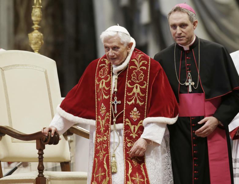 XVI flanked by personal secretary Archbishop Georg Gaenswein during a Mass to mark the 900th anniversary of the Order of the Knights of Malta in St. Peter's Basilica at the Vatican. Archbishop G