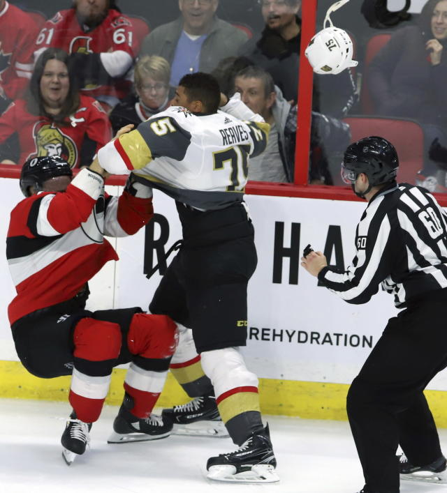 Ottawa Senators defenseman Mark Borowiecki (74) and Vegas Golden Knights right wing Ryan Reaves (75) fight during the second period of an NHL hockey game, Wednesday, Nov. 8, 2018 in Ottawa, Ontario. (Fred Chartrand/The Canadian Press via AP)