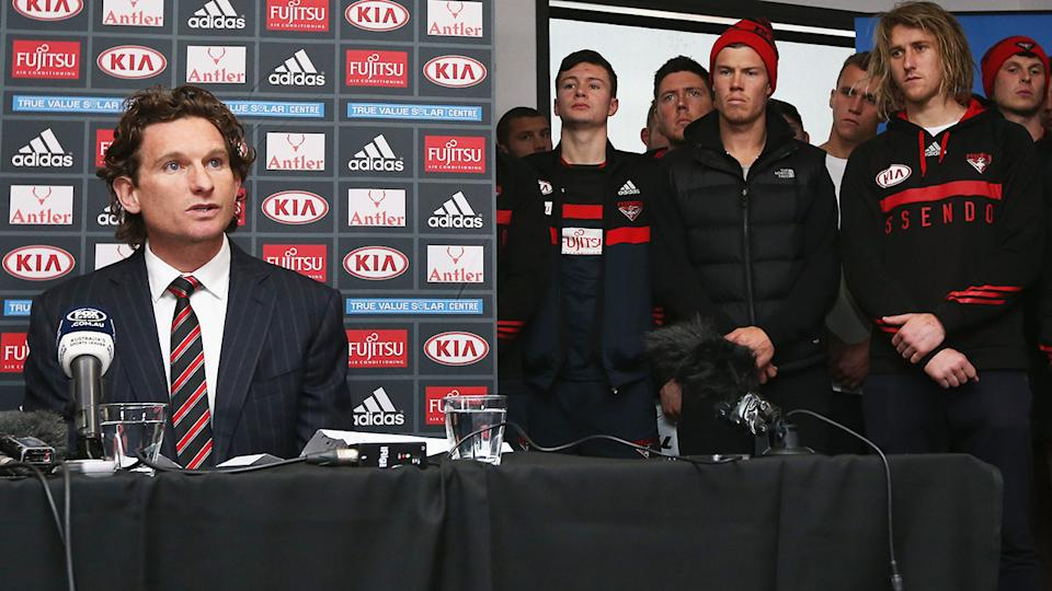 James Hird is pictured announcing he will no longer coach the Essendon Bombers during a 2015 press conference.