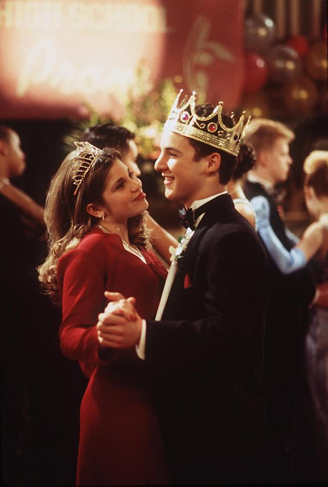 <p>Topanga (Danielle Fishel) and Cory (Ben Savage) manage to be crowned Prom Queen and King — it must have been Topanga's eye-catching two-piece red dress. (Photo: ABC/Getty Images) </p>