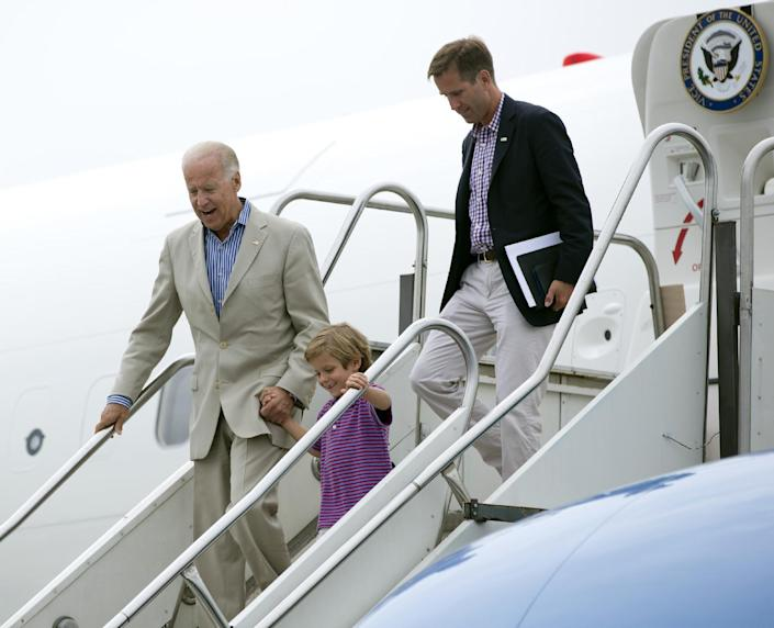 Vice President Joe Biden arrives at Harrisburg International Airport with his grandson Hunter Biden and son Beau Biden, right, Sunday, Sept. 2, 2012, in Middletown, Pa. (AP Photo/Carolyn Kaster)