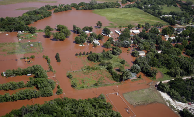 Flooding in Kingfisher, Okla. is pictured from the air, Tuesday, May 21, 2019. Flooding following heavy rains was an issue across the state. (AP Photo/Sue Ogrocki)