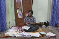 """Gharu Bhatti, an activist working for the welfare of lower caste Hindus, shows his paperwork in Jammu, India, July 30, 2020. A year after India ended disputed Kashmir's semi-autonomous status and downgraded it to a federally governed territory, authorities have begun issuing residency and land ownership rights to outsiders for the first time in almost a century. Bhatti said that the domicile law ended their """"slavery."""" Bhatti's parents were among some 270 sanitation workers brought by the government to Jammu from neighboring Punjab state in 1957. Since then, their numbers have grown to nearly 7,000, said Bhatti, who is among the first few dozen from his community to get the region's residency. Documents accessed and reviewed by The Associated Press show at least 60,000 have gained residency in the last two months including Hindu refugees, Gurkha soldiers and bureaucrats. (AP Photo/Channi Anand)"""